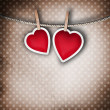 Valentine background: two hearts hanging on clothespin. Couple c - Stock Photo