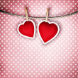 Valentine background: two hearts hanging on clothespin. Couple c — Stockfoto