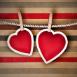 Valentine background: two hearts hanging on clothespin. Couple c — Zdjęcie stockowe