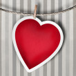 Valentine background: heart hanging on clothespin — Stock Photo #17217181