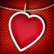Valentine background: heart hanging on clothespin - Stock Photo