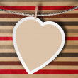 Valentine background: heart hanging on clothespin — Stock Photo #17217191
