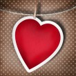 Valentine background: heart hanging on clothespin — Stock Photo