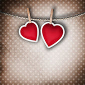 Valentine background: two hearts hanging on clothespin. Couple c — Стоковое фото