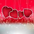 Valentine heart hanging labels on shining background — Stock Photo