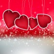 Valentine heart hanging labels on shining background - Stock Photo