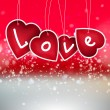 Stock Photo: Valentine heart hanging labels on shining background