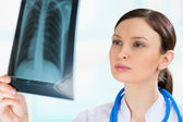 Female doctor looking at a lungs or torso xray, fluorography — Stock Photo