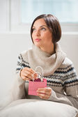 Portrait of a woman preparing surprise to her husband or boyfriend — Stock Photo