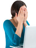 Young tired woman face palm working on laptop — Stock Photo