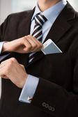 Closeup of torso of confident business man wearing elegant suit — Stock Photo