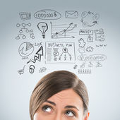 Young business woman thinking of her plans closeup face portrait — Stockfoto