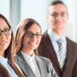 Group of a successful business standing together — Stock Photo
