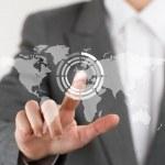 ビジネスの女性の世界の ma の仮想ボタンを彼女の指を指しています。 — ストック写真