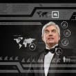Businessman standing and working wth touch screen technology — Foto de Stock