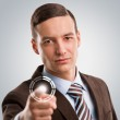 Business man pushing virtual button on touch screen — Stock Photo