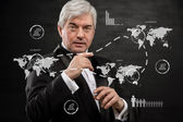 Solid business man working with virtual interface - building int — Stock Photo