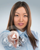 Asian business woman pressing social media icon — Stock Photo