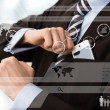 Businessman in luxury suit in front of digital vurtual screen — Stock Photo