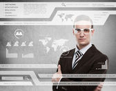 Businessman standing and working with touch screen technology — Stock Photo