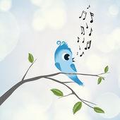 Cute bird sings on branch — Stock Photo