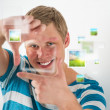 Young man making frame gesture with his fingers, virtual pictures — Stock Photo