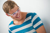 Closeup portrait of handsome young man wearing glasses — Stock Photo