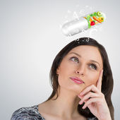 Healthy life concept. Woman with vitamins overhead — Stock Photo