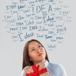 Gift Idea concept. Young business woman with gift and idea sign — Stock Photo