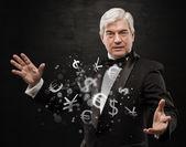 Concept d'investissement. homme d'affaires beau avec symboles monétaires. — Photo