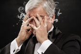 Bad Investment concept. Sad business man with currency symbols. — Stock Photo