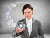 Businesswoman and virtual interface with web and social media icons — Stock Photo