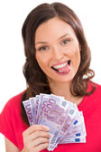 Woman holding up fanned out banknotes — Stock Photo