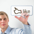 Business man touching social media button with thumb up symbol — Stock Photo