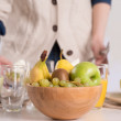 Human hands preparing table for lunch - Stock Photo