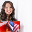 Portrait of a lovely young woman with different countries flags — Stock Photo