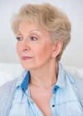Portrait of an attractive elegant senior woman relaxingand dream — Stock Photo