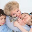 Portrait of smiling grandmother and grandchildren hugging — Stock Photo #25601467