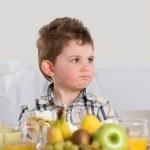 Child on breakfast — Stock Photo #26008831