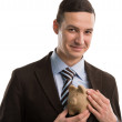 Business man hiding piggybank — Stockfoto