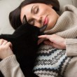 Pretty young woman with her cat — Stock Photo