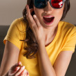 Expressive young woman watching 3d film — Stock Photo