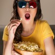 Beautiful girl watching movie — Stock Photo