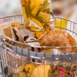 Grocery store. Supermarket basket full of different food — Stock Photo