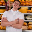 Handsome male owner of a cheese store — Stock Photo