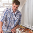 Young man shopping for frozen food in a grocery store — Stock Photo