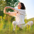 Stretching woman in outdoor exercise smiling happy doing yoga — Stock Photo