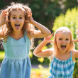 Stock Photo: Little girls having fun together