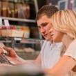 Couple shopping at the supermarket — Stock Photo