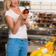 Woman shopping at the supermarket — Stock Photo #29403755